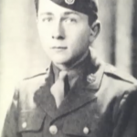 Young man in military uniform, straight-faced
