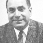 Man smiling in a suit, black and white