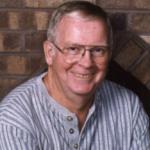 Man wearing glasses, smiling