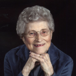 Woman wearing glasses, smiling