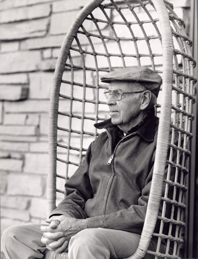 Man sitting in a chair, outside