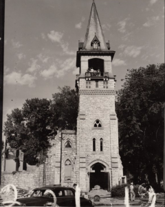 Black and white photo of a church's steeple