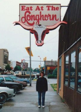 Marking the memory a student poses under the Longhorn sign, circa 1990